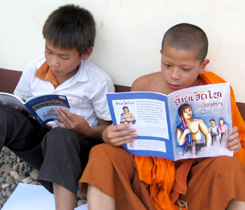 The book Aijethai and other traditional stories from Laos being read