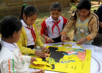 students assemble a puzzle map of Southeast Asia