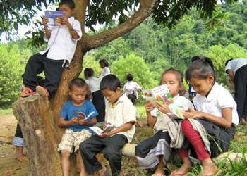 Lao schoolchildren reading, after they get their first book