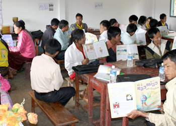 Teachers practice read-aloud skills with Big Brother Mouse, at a workshop organized by Save the Children