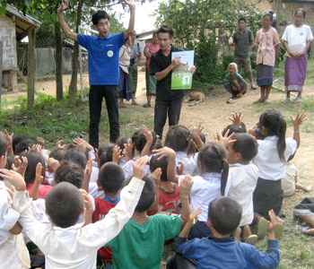 Briefly teaching Lao sign language at a rural Lao school